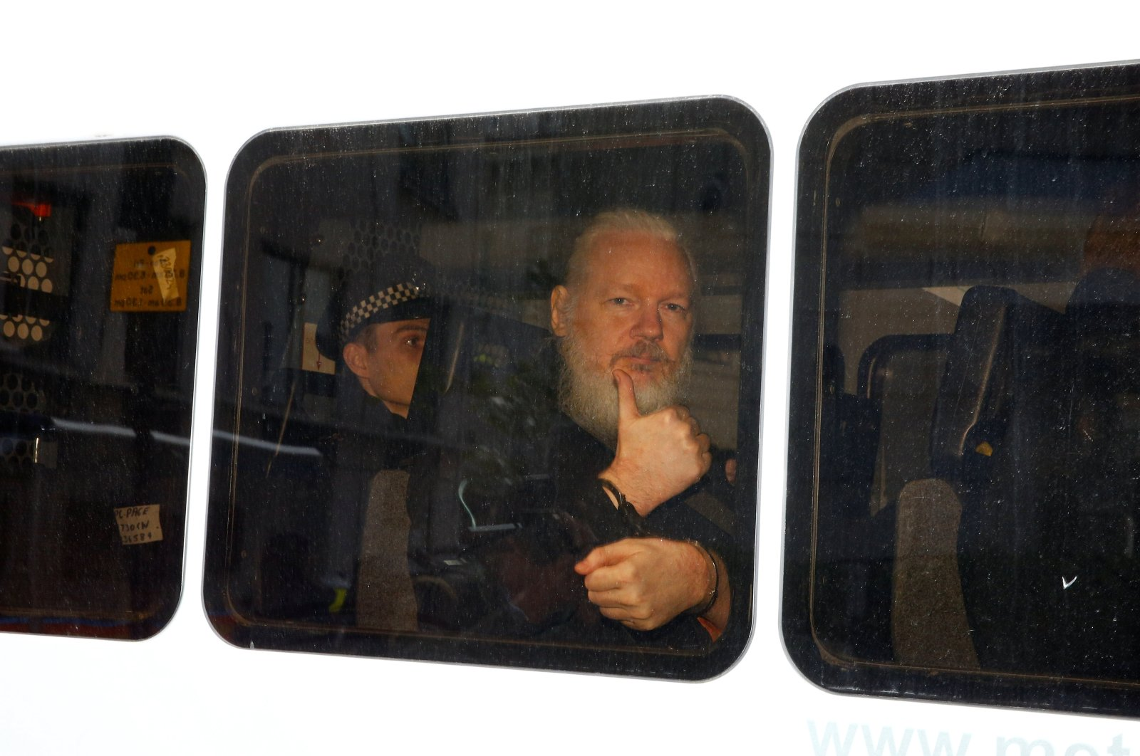 WikiLeaks founder Julian Assange is seen in a police van after he was arrested by British police outside the Ecuadorian embassy, London, April 11, 2019. (Reuters Photo)