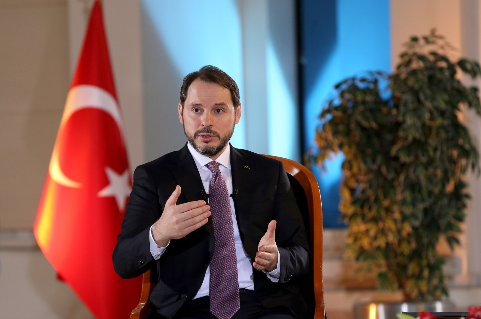 Treasury and Finance Minister Albayrak speaks in a televised interview, Thursday, March 19, 2020. (AA Photo)