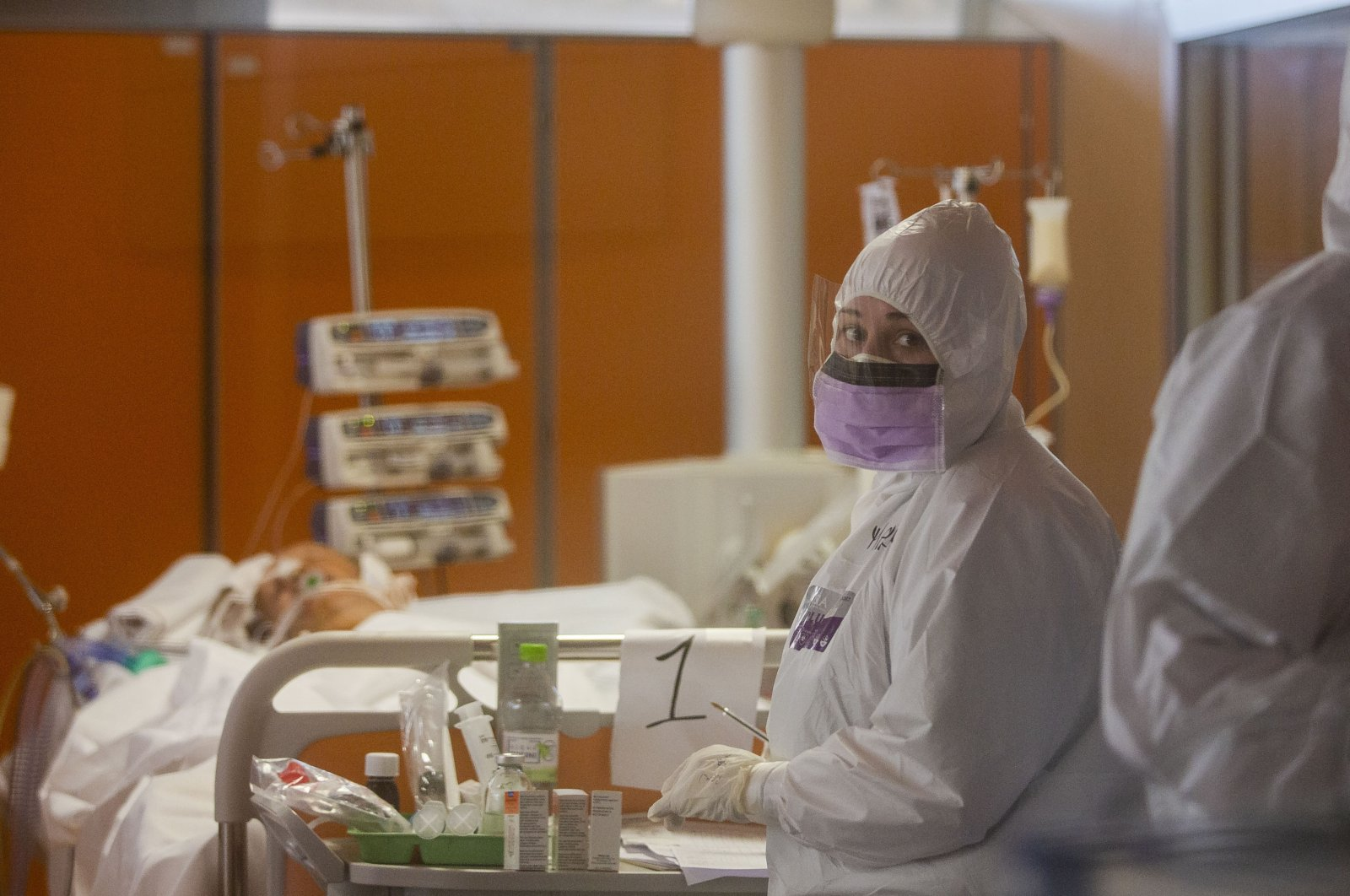 Medical staff at the Intensive Care Unit of the Casalpalocco COVID-19 Clinic on the outskirts of Rome tends to patients, Wednesday, March 25, 2020. (AP Photo)