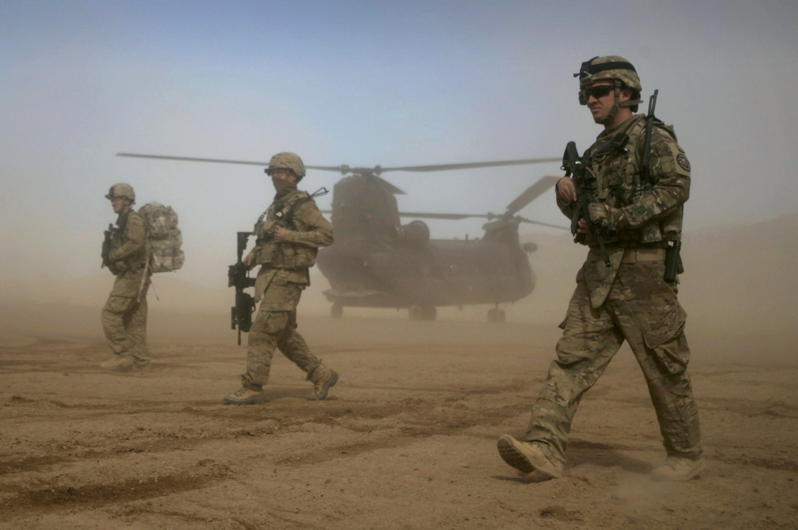 U.S. soldiers, part of the NATO- led International Security Assistance Force (ISAF), walk west of Kabul, Afghanistan, Jan. 28, 2012. (AP Photo)