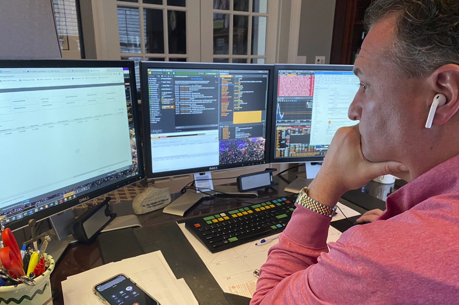 In this image provided by Jonathan Corpina, Jonathan Corpina, Senior Managing Partner at Meridian Equity Partners Inc., who normally works on the New York Stock Exchange trading floor, works in his home office in Armonk, NY., Wednesday, March 25, 2020. (AP Photo)