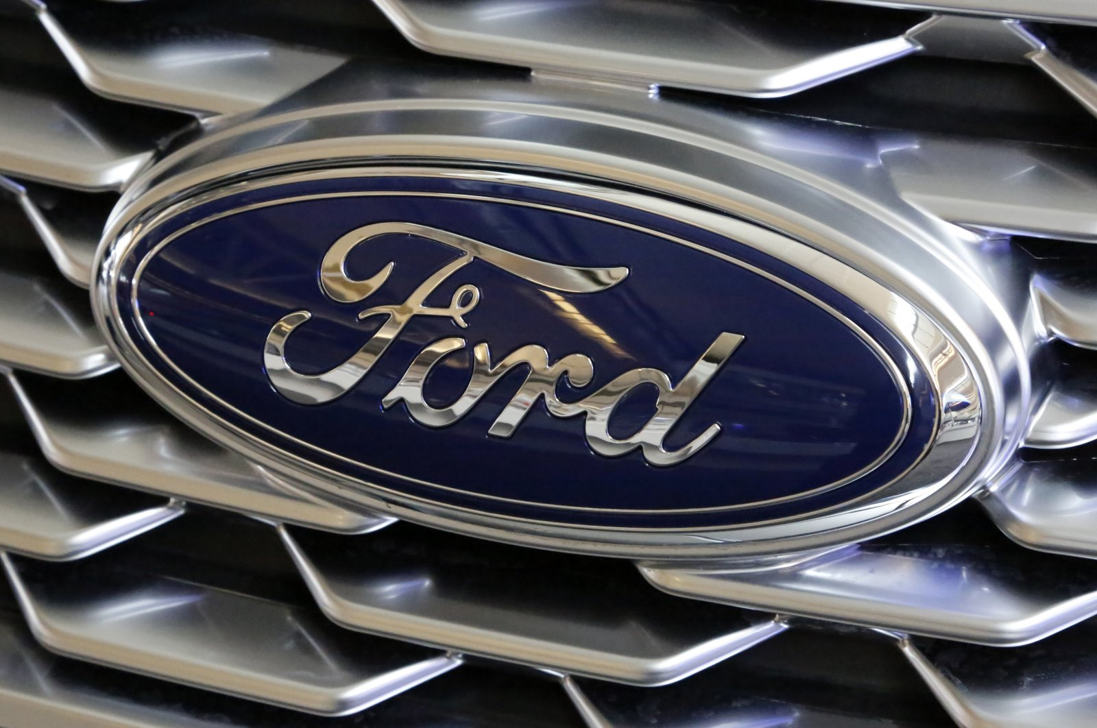 This Feb. 15, 2018, photo shows a Ford logo on display at the Pittsburgh Auto Show in Pittsburgh. (AP Photo)