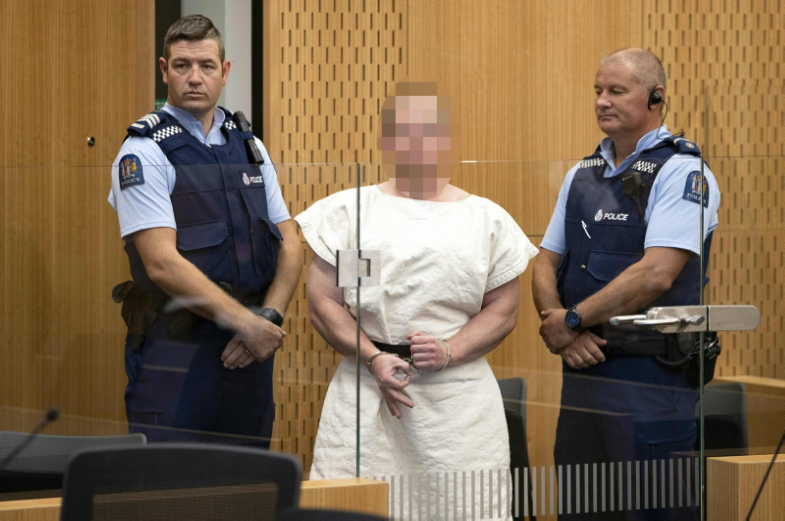 Brenton Tarrant, the terrorist charged in relation to the Christchurch massacre, makes a sign to the camera during his appearance in the Christchurch District Court on March 16, 2019. (AFP Photo)