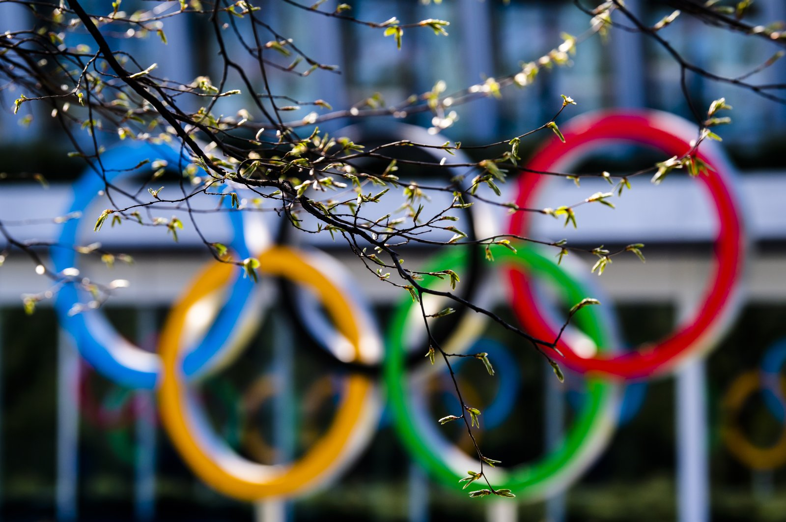The Olympic rings are pictured at the entrance of the International Olympic Committee headquarters during the coronavirus outbreak in Lausanne, Switzerland, Tuesday, March 24, 2020. (Keystone via AP)
