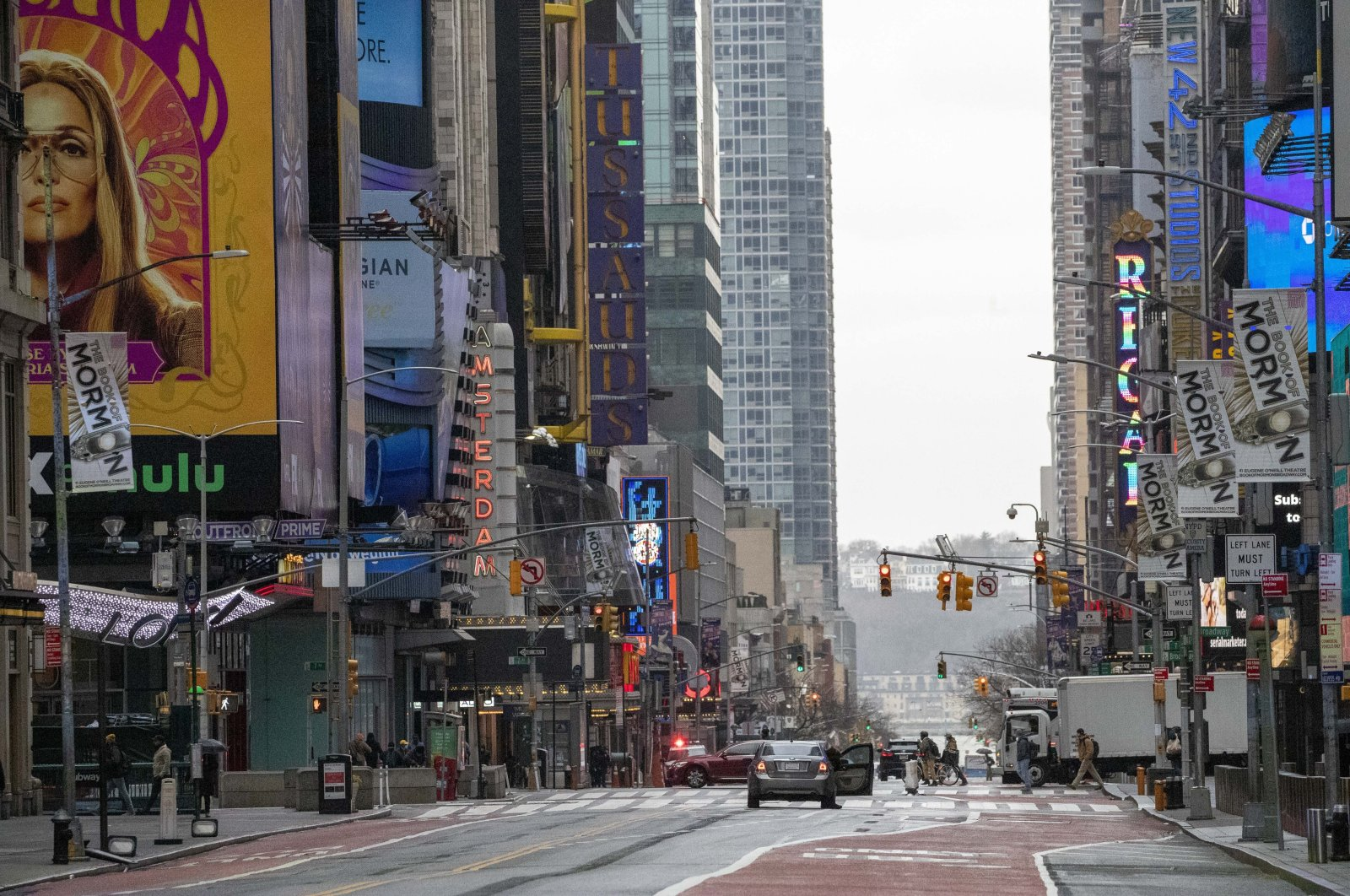 Light traffic is seen on 42nd St. in New York's Times Square, Wednesday, March 25, 2020. (AP Photo)