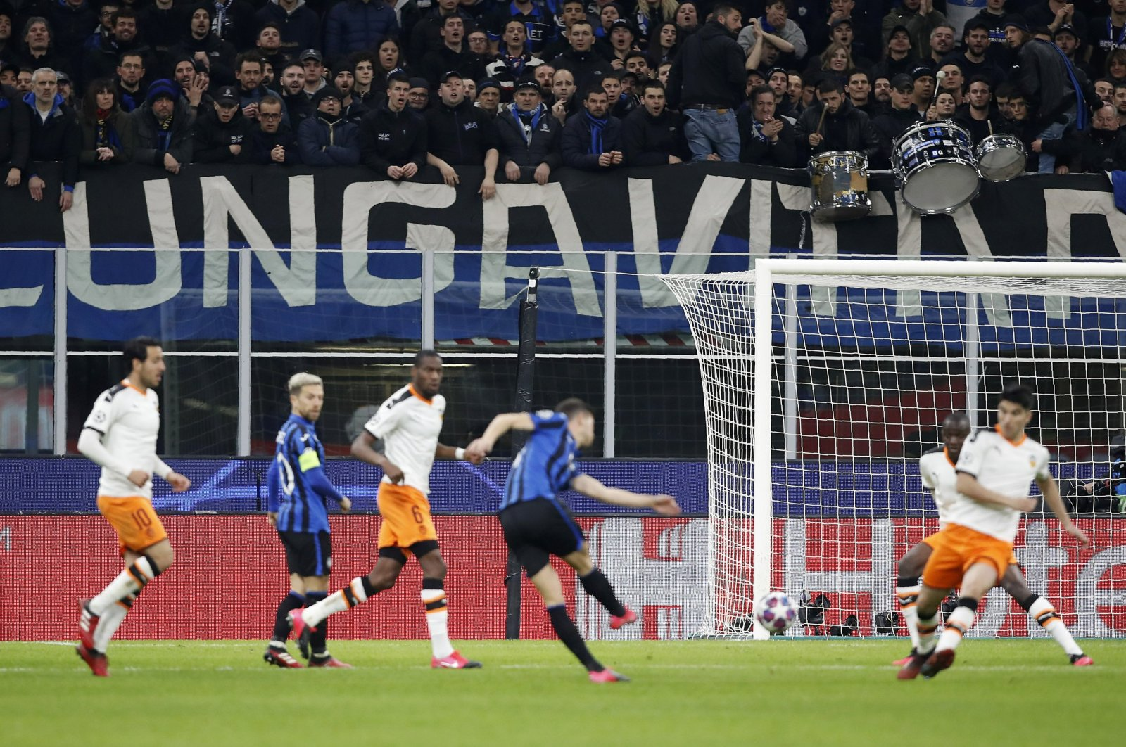 Spectators sit in the stands during the Champions League round of 16 match between Atalanta and Valencia at the San Siro stadium in Milan, Italy, Feb. 19, 2020. (AP Photo)