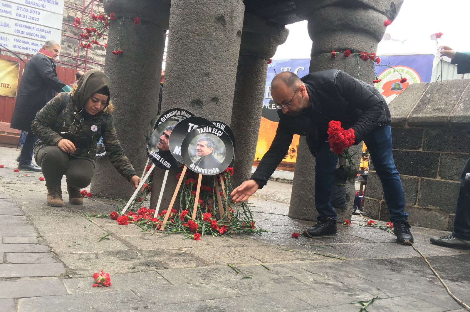 People leave flowers at the scene where Tahir Elçi was killed, in Diyarbakır, Turkey, Nov. 28, 2019. (DHA Photo)