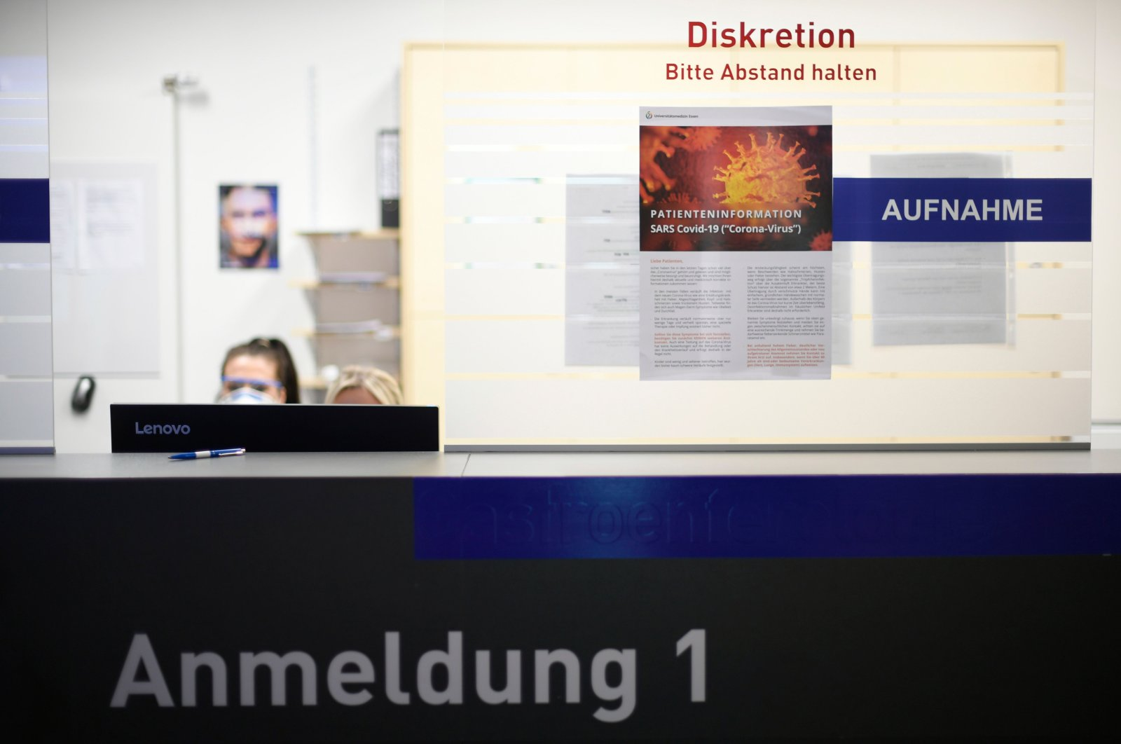 A nurse works at the registration desk of the central reception center for coronavirus cases at a university hospital in Essen, western Germany, Thursday, March 26, 2020. (AFP Photo)