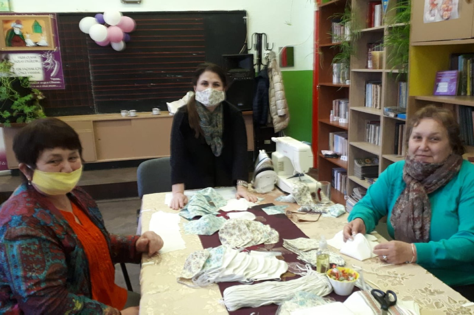 Three women sew masks for the needy in the town of Dobric, Wednesday, March 25, 2020. (DHA Photo)