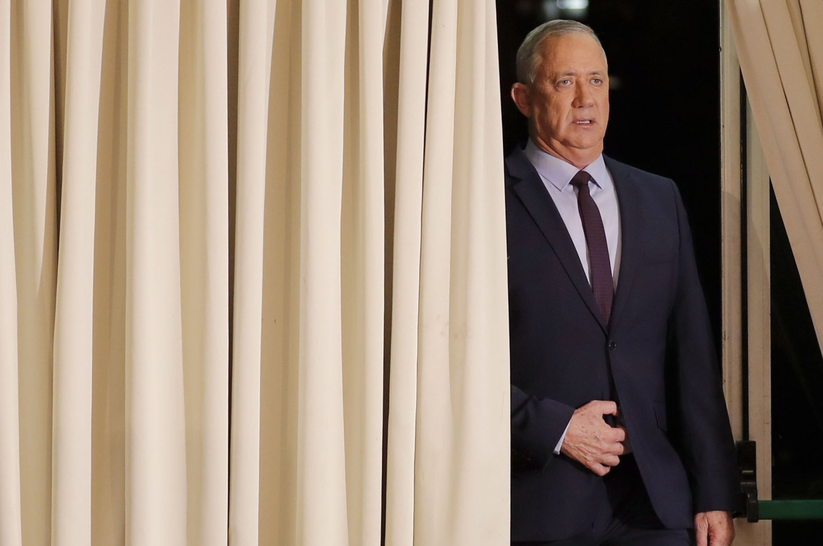A file photo taken March 7, 2020, shows the leader of Israel's Blue and White electoral alliance Benny Gantz arriving to deliver a statement in the central Israeli city of Ramat Gan. (AFP Photo)