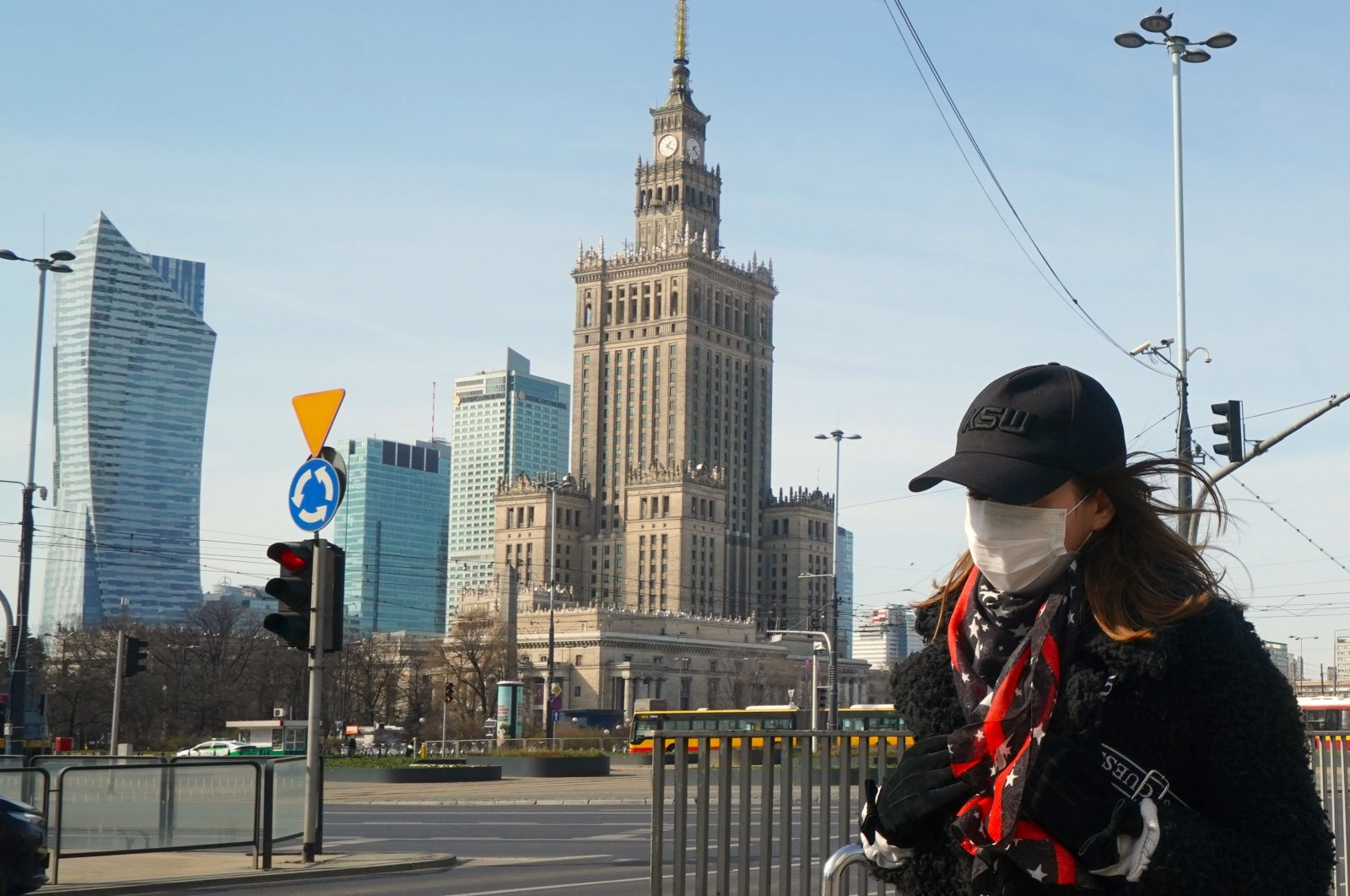 A woman with a face mask walk on March 26, 2020 on a street of Warsaw, amid the novel coronavirus pandemic. (AFP Photo)