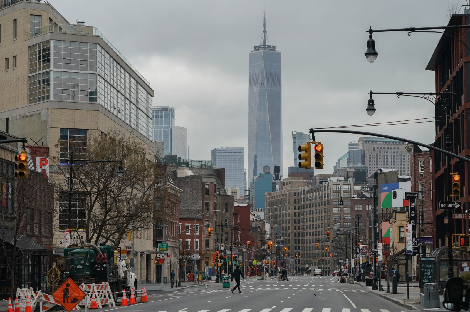 The World Trade Center rises over a nearly empty Seventh Avenue in the West Village, New York, Thursday, March 25, 2020.