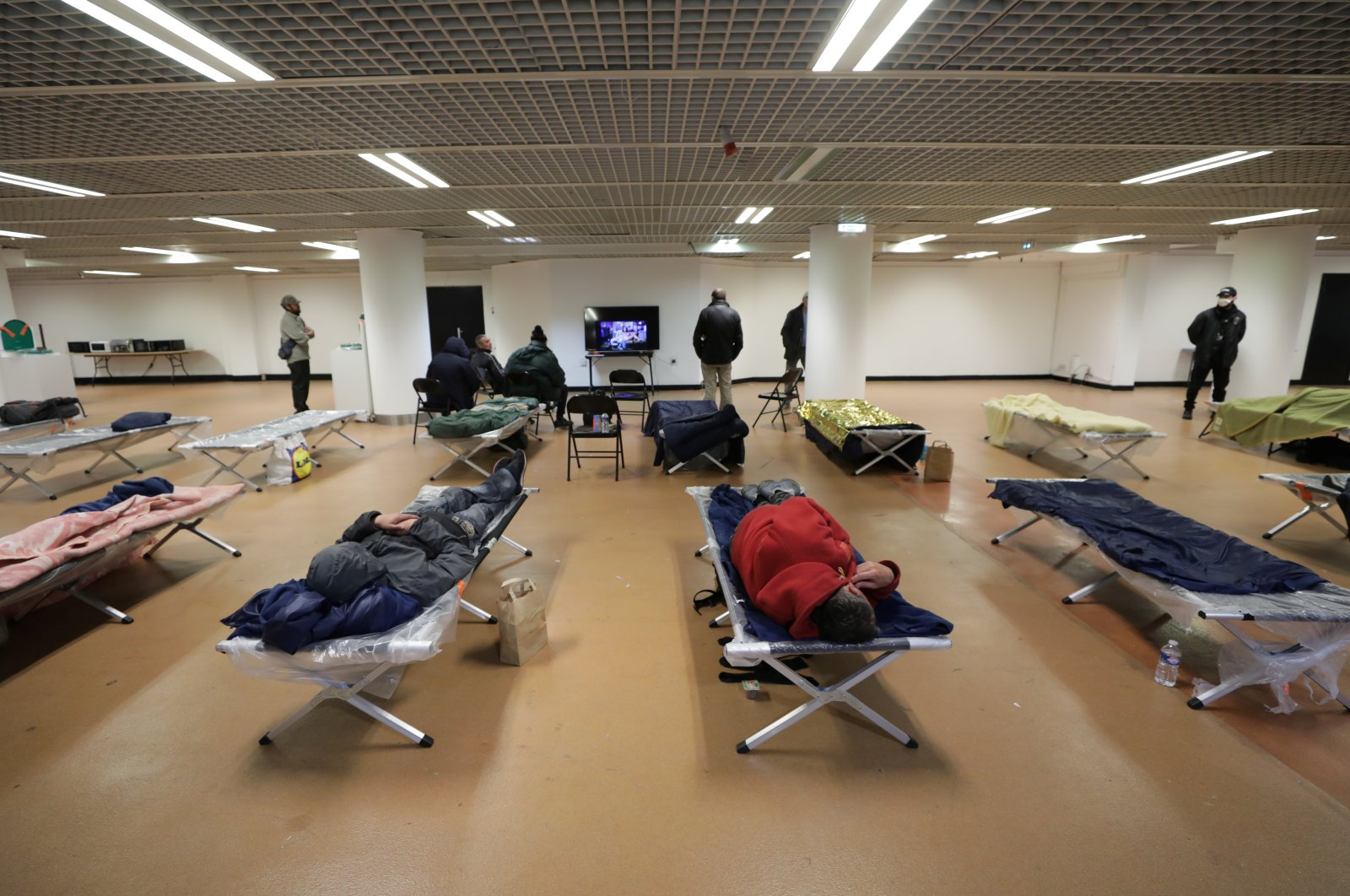 Homeless people sleep inside the Festival palace in France, Tuesday, March 24, 2020. (Reuters Photo)