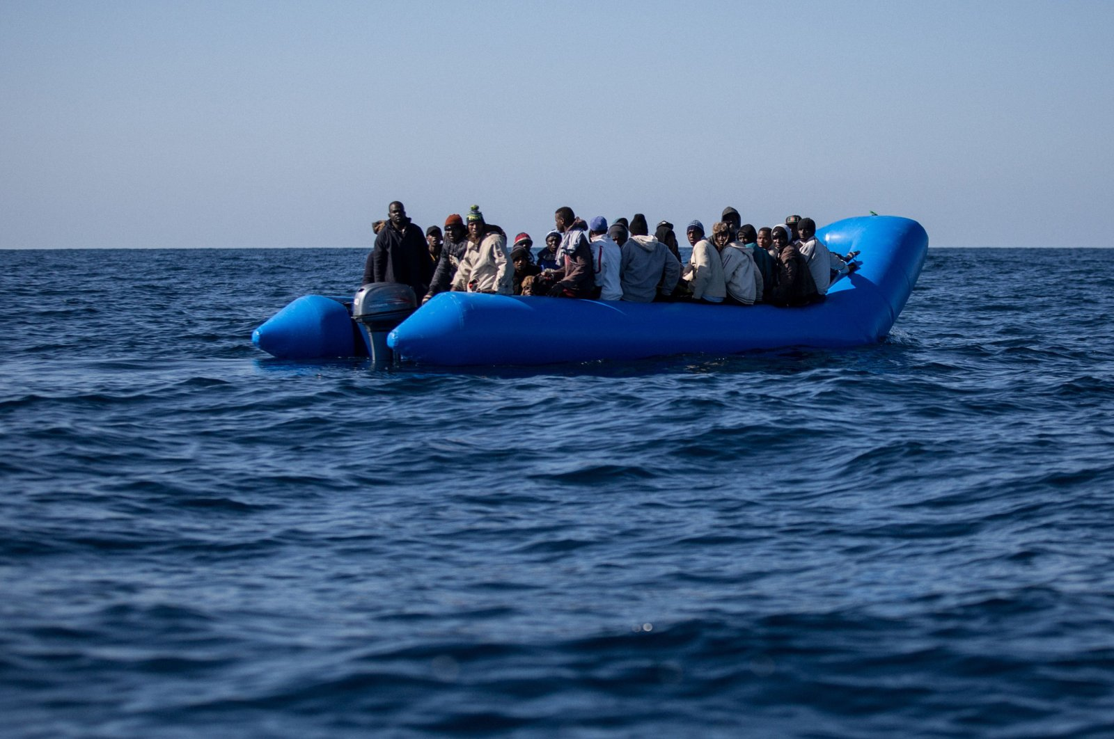 An inflatable boat with 47 migrants on board is pictured while being rescued by the Dutch-flagged Sea Watch 3 off Libya's coasts, Jan. 19, 2019. (AFP Photo)
