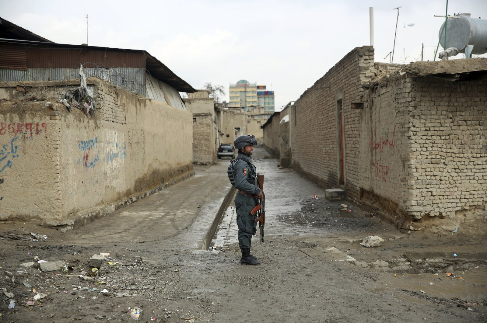 An Afghan security guard stands at the site of an attack in Kabul, Wednesday, March 25, 2020. (AP Photo)