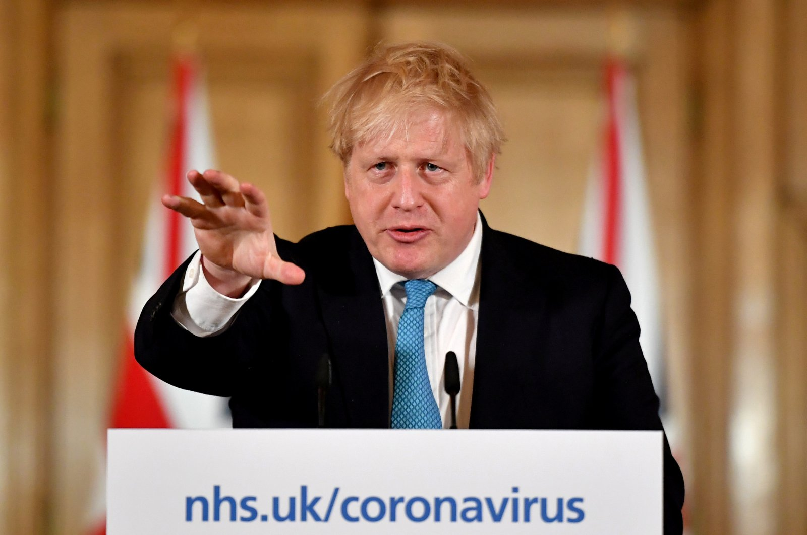 British Prime Minister Boris Johnson gestures as he speaks during a coronavirus-related news conference inside 10 Downing Street, London, Britain, Thursday, March 19, 2020. (Reuters Photo)