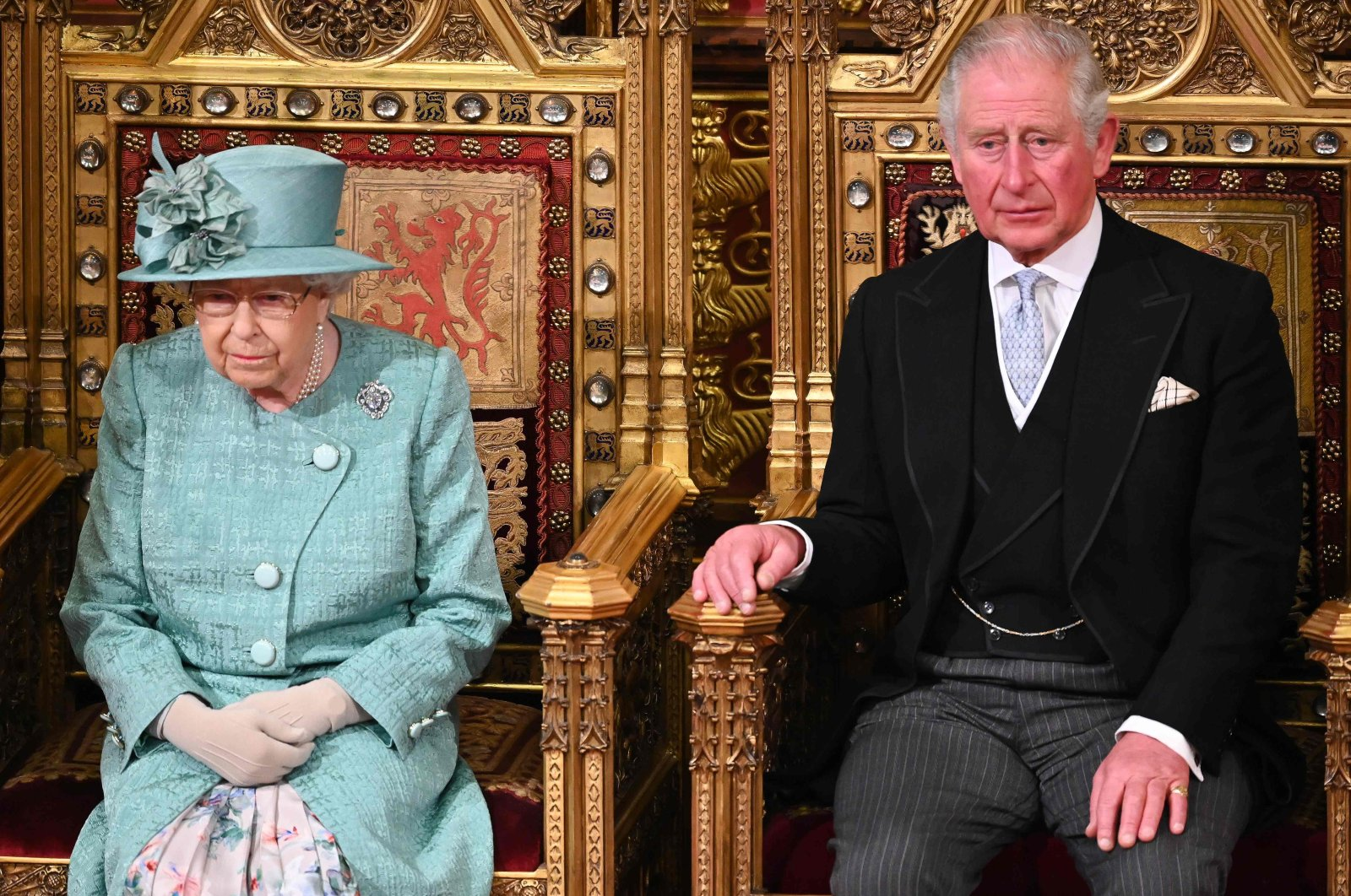Britain's Prince Charles sits with Queen Elizabeth II on the Sovereign's Throne before she delivered the Queen's Speech in the House of Lords chamber, during the state opening of Parliament in the Houses of Parliament, London, Dec. 19, 2019. (AFP Photo)