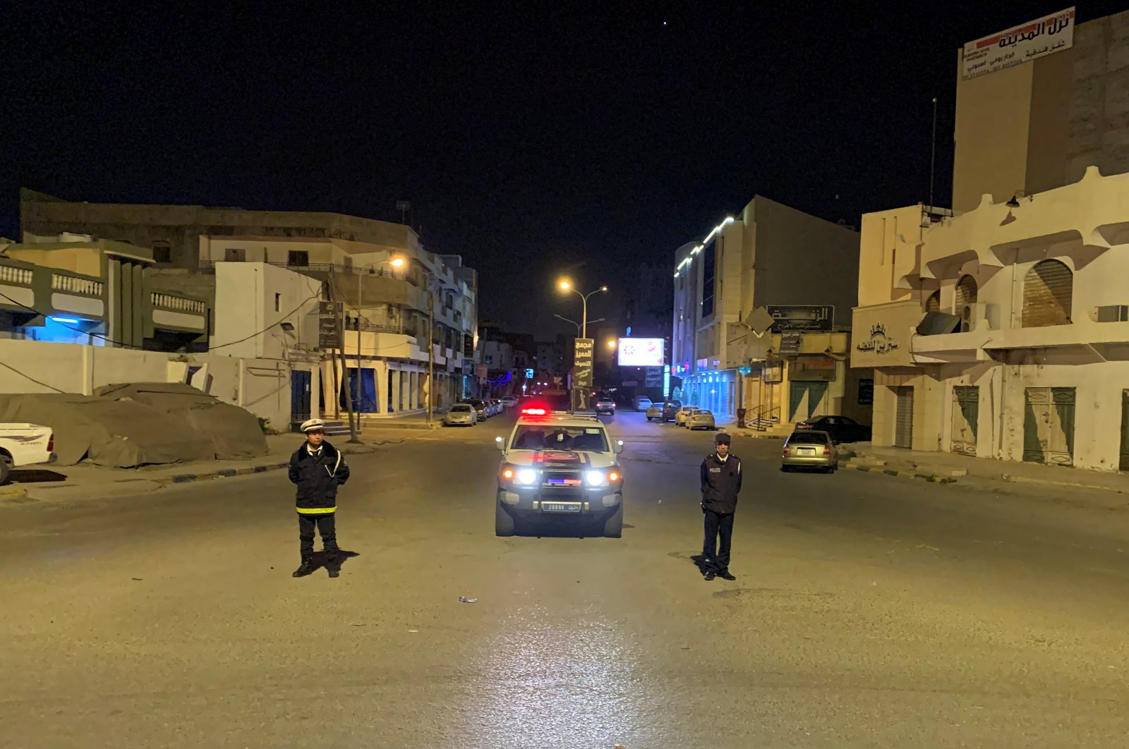 Police officers stand in the middle of the road during a curfew, imposed by the Libyan government as part of precautionary measures against coronavirus disease (COVID-19), in Misrata, Sunday, March 22, 2020. (REUTERS Photo)