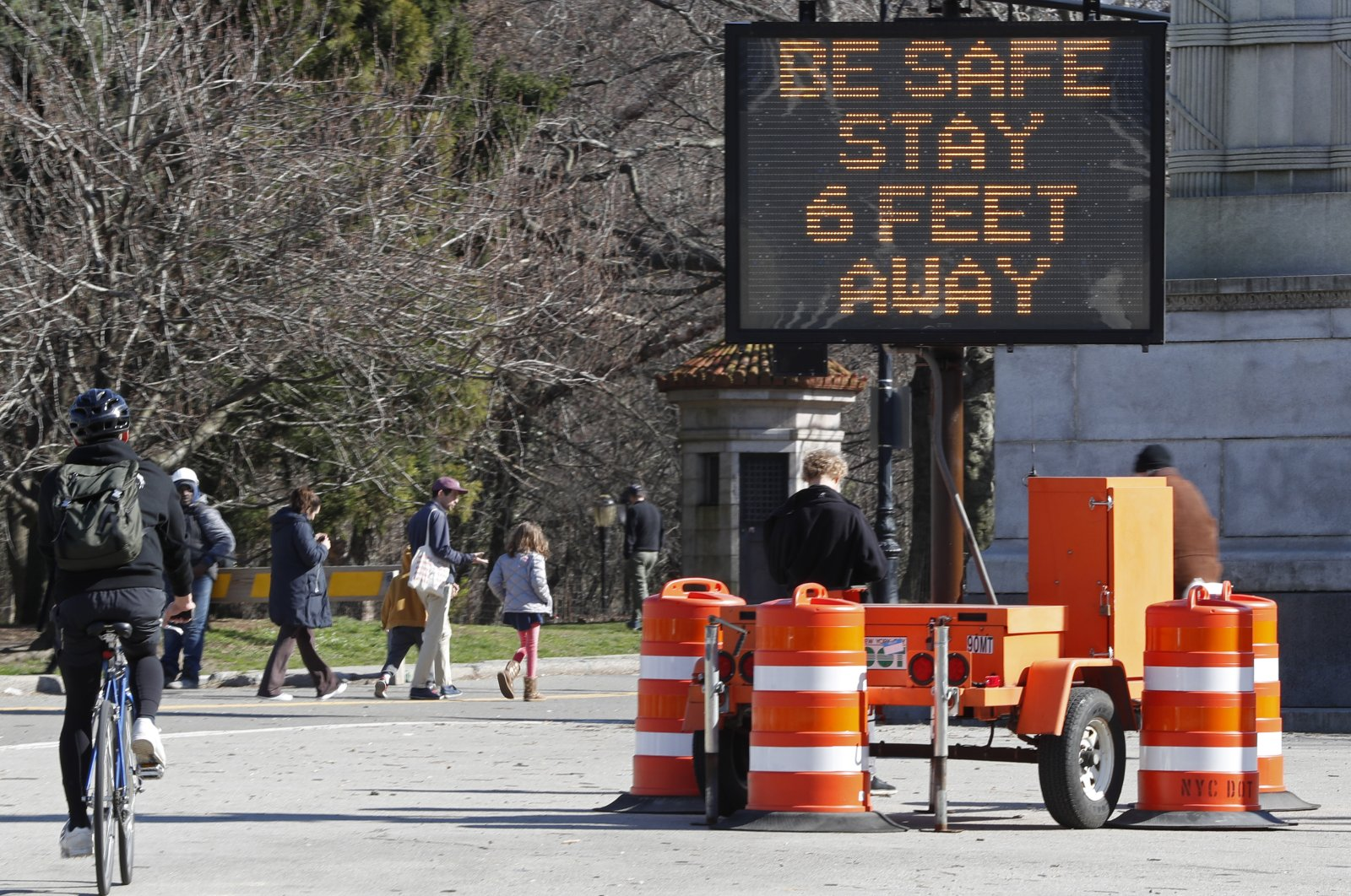 A large sign in Brooklyn's Prospect Park encourages people to practice social distancing by standing 6 feet apart, New York City, Thursday, March 26, 2020. (AP Photo)