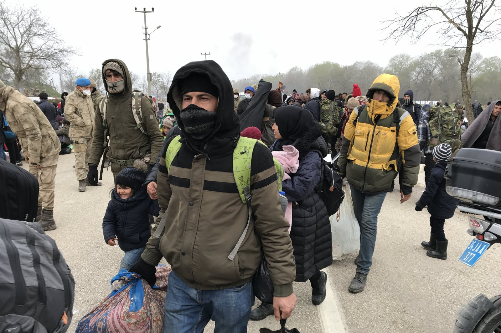 Migrants at Greek-Turkish border ended their 30-day-long wait and left the region amid the coronavirus outbreak, Friday, March 27, 2020. (AA)