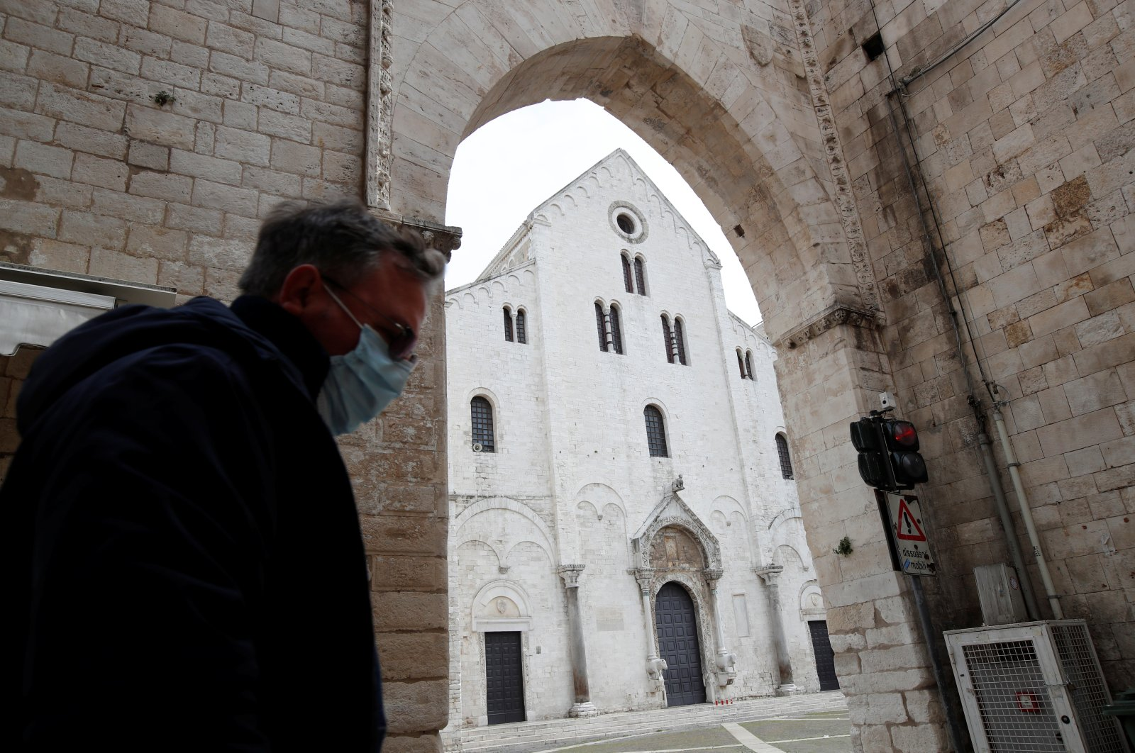 A general view as a man wearing a protective face mask walks past the Basilica of St. Nicholas, protector of Bari as the spread of the coronavirus disease (COVID-19) continues, in Bari, Italy, March 27, 2020. (Reuters Photo)