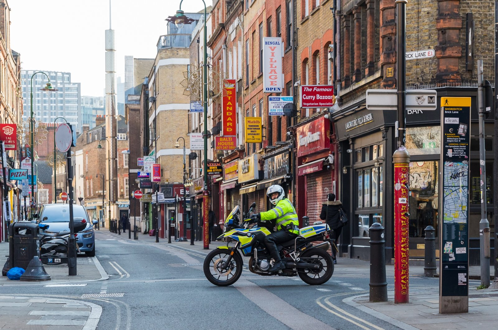 A police officer patrolling on a motorbike seen on an empty Brick Lane in east London, Britain, March 27, 2020. (EPA Photo)