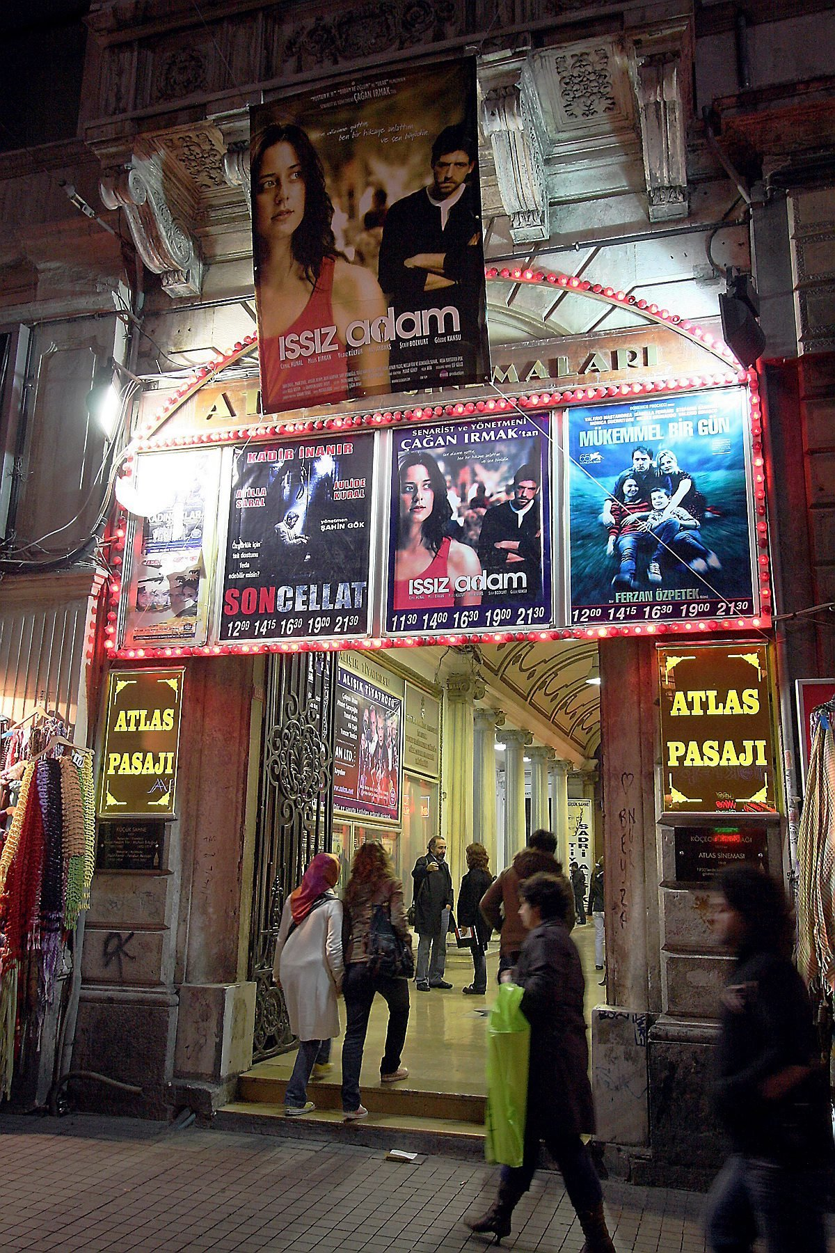 This file photo shows the entrance of Atlas Passage, which houses the movie theater bearing the same name, on Nov. 16, 2008. The banner belongs to the 2008 movie