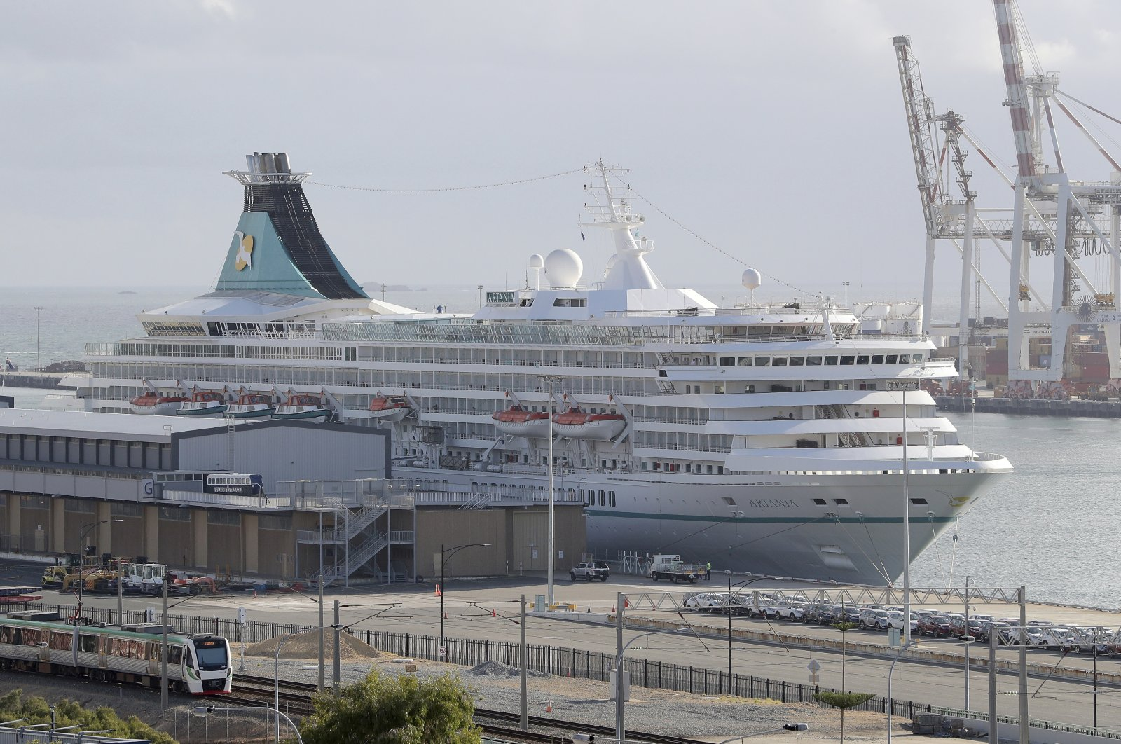 This photo shows the cruise ship Artania docked at Fremantle harbour in Fremantle, Australia on Friday, March 27, 2020. (AAP Image via AP)