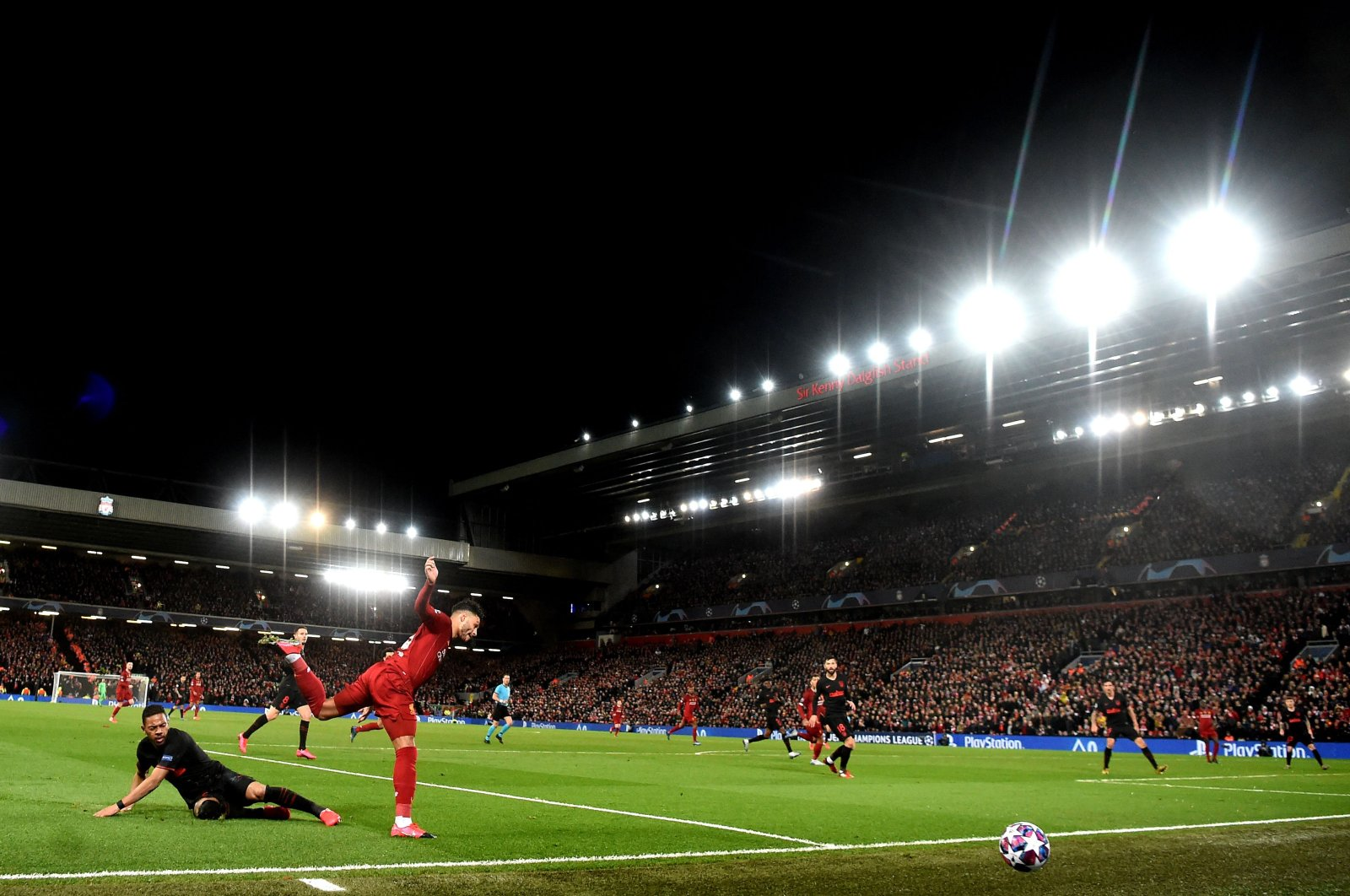 Liverpool's English midfielder Alex Oxlade-Chamberlain (2L) controls the ball during the UEFA Champions League Round of 16-second leg football match between Liverpool and Atletico Madrid at Anfield in Liverpool, England on March 11, 2020. (AFP Photo)