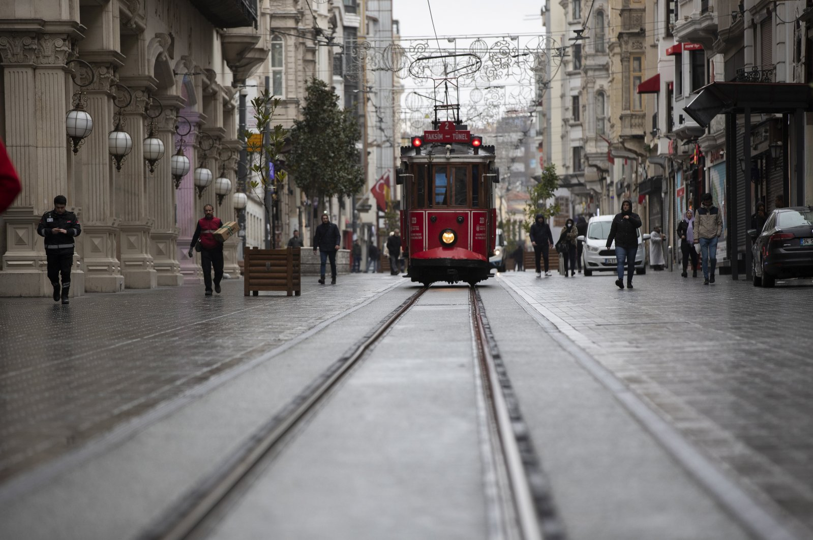 A few people can be seen walking on the usually bustling Istiklal Street which looks eerily empty over coronavirus concerns in Istanbul, Turkey, Tuesday, 24 March 2020. (EPA-EFE Photo)