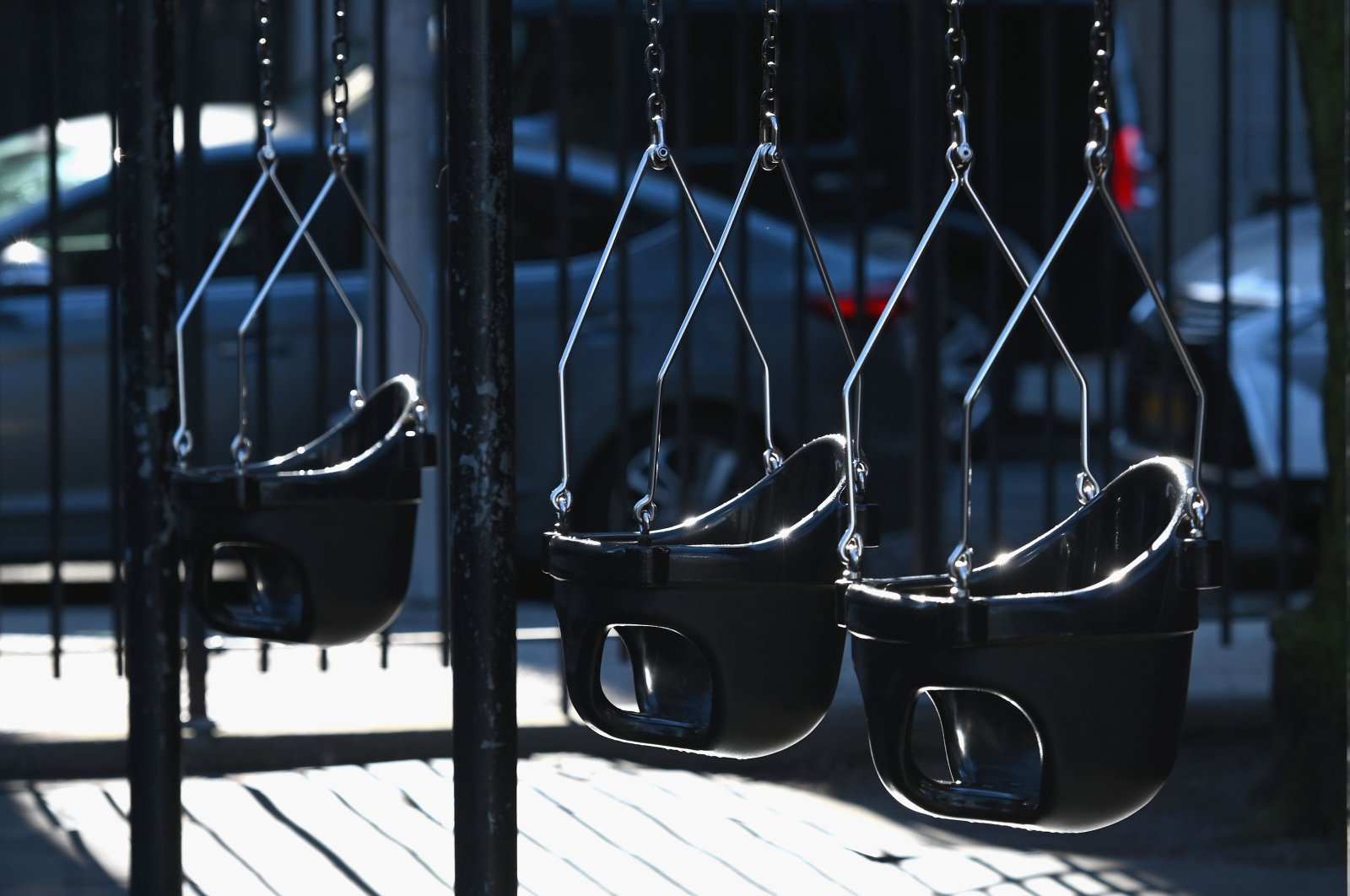 Empty swings are seen on a playground, New York City, Tuesday, March 24, 2020. (AFP Photo)
