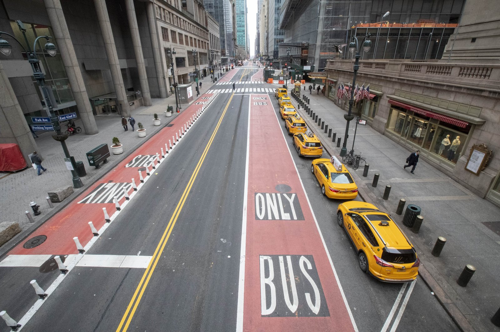 Yellow cabs line up on an empty 42nd Street waiting for fares outside Grand Central Terminal in New York, Wednesday, March 25, 2020. For the millions of Americans living under some form of lockdown to curb the spread of the new coronavirus, not knowing when the restrictions will end is a major source of anxiety. (AP Photo)
