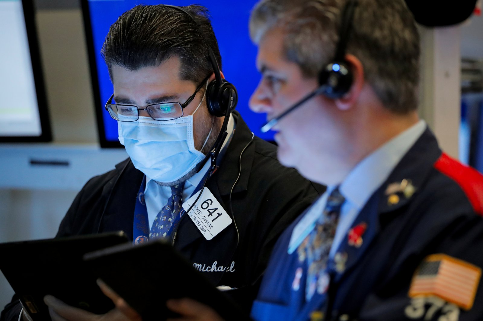 Traders work on the floor of the New York Stock Exchange in New York, U.S., Friday, March 20, 2020. (Reuters Photo)