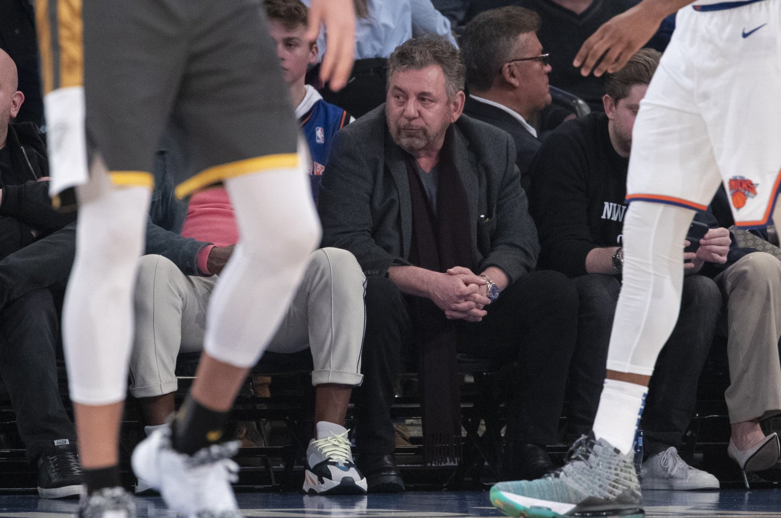 New York Knicks owner James Dolan (C) watches the first half of an NBA basketball game in New York, U.S.,  March 6, 2020. (AP Photo)