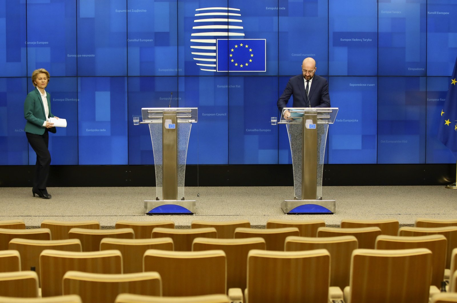 European Council President Charles Michel, right, and European Commission President Ursula von der Leyen, left, arrive to address a nearly empty press theater, Brussels, Monday, March 16, 2020. (AP Photo)