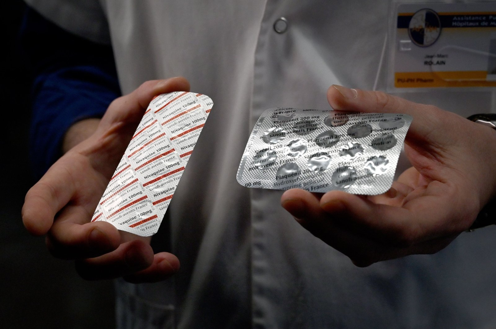 In this file photo taken on February 26, 2020, a medical staff shows at the IHU Mediterranee Infection Institute in Marseille, packets of a Nivaquine, tablets containing chloroquine and Plaqueril, tablets containing hydroxychloroquine, drugs that have shown signs of effectiveness against coronavirus. (AFP Photo)