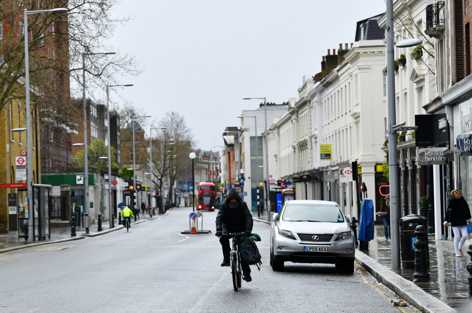 A man rides a bicycle on Kings Road, London, March 29, 2020. (REUTERS Photo)