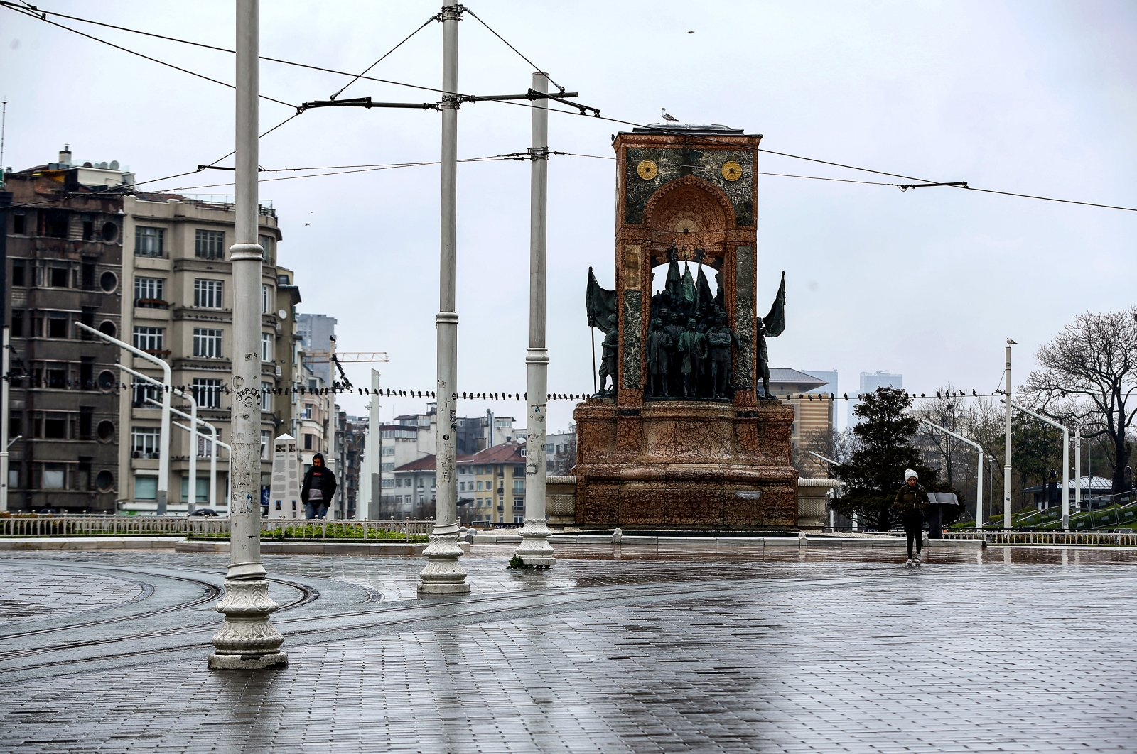 The nearly empty Taksim Square in Istanbul, Sunday, March 29, 2020. (AA Photo)