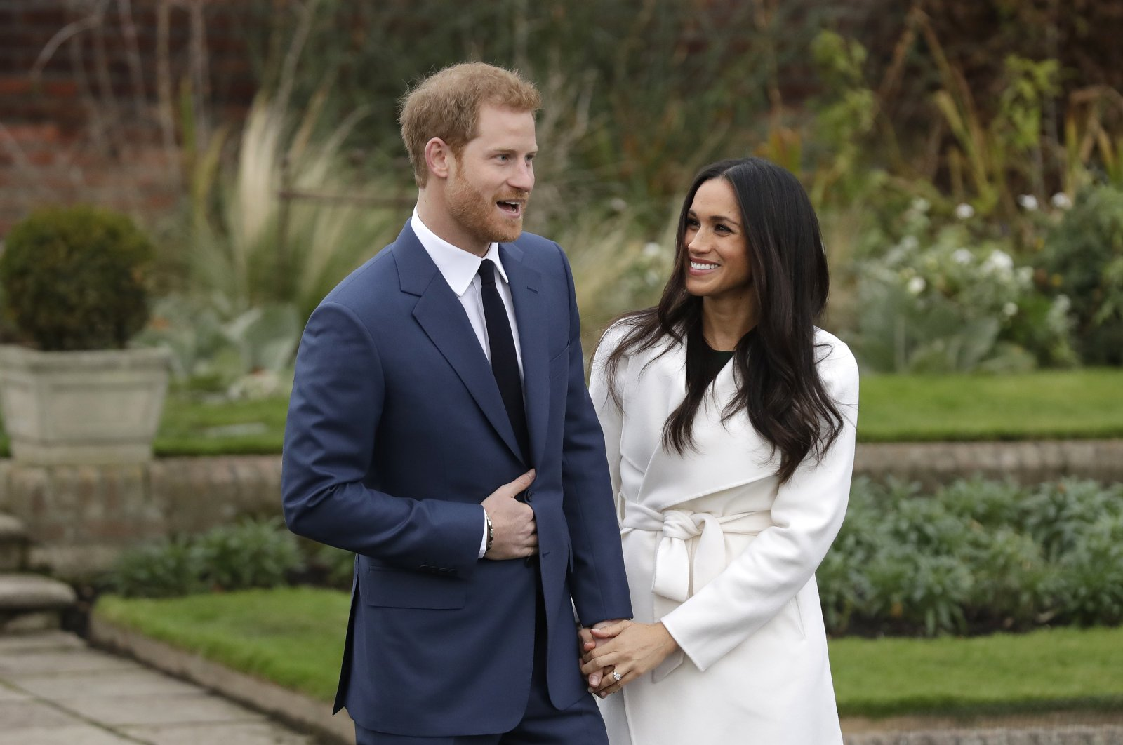 In this Monday, Nov. 27, 2017, file photo, Britain's Prince Harry and his fiancee Meghan Markle pose for photographers on the grounds of Kensington Palace in London, after announcing their engagement. (AP Photo)