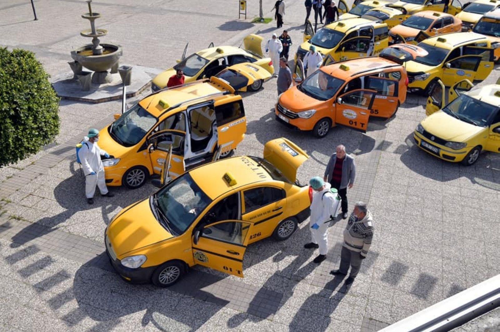 Taxis are disinfected as a measure to prevent the spread of the coronavirus, Çukurova district, Adana province, Turkey, Friday, March 27, 2020. (İHA Photo)