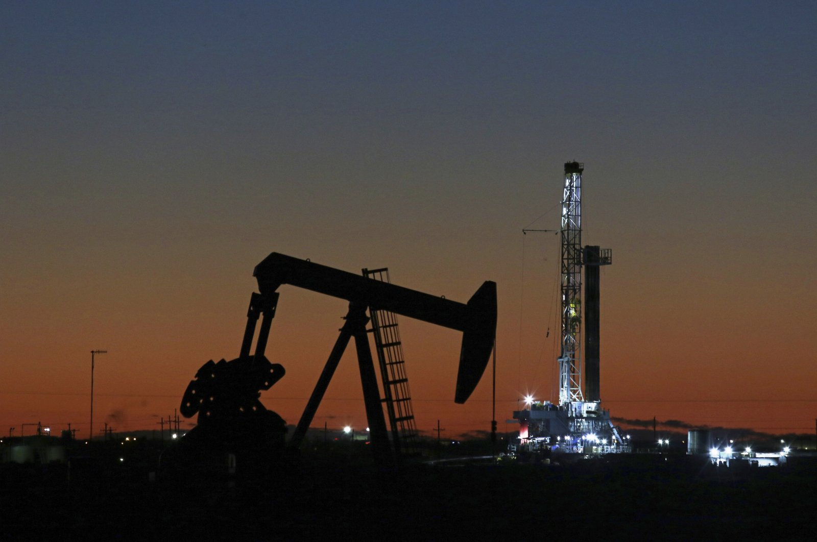 This file photo shows an oil rig and pump jack in Midland, Texas, Oct. 9, 2018. (AP Photo)