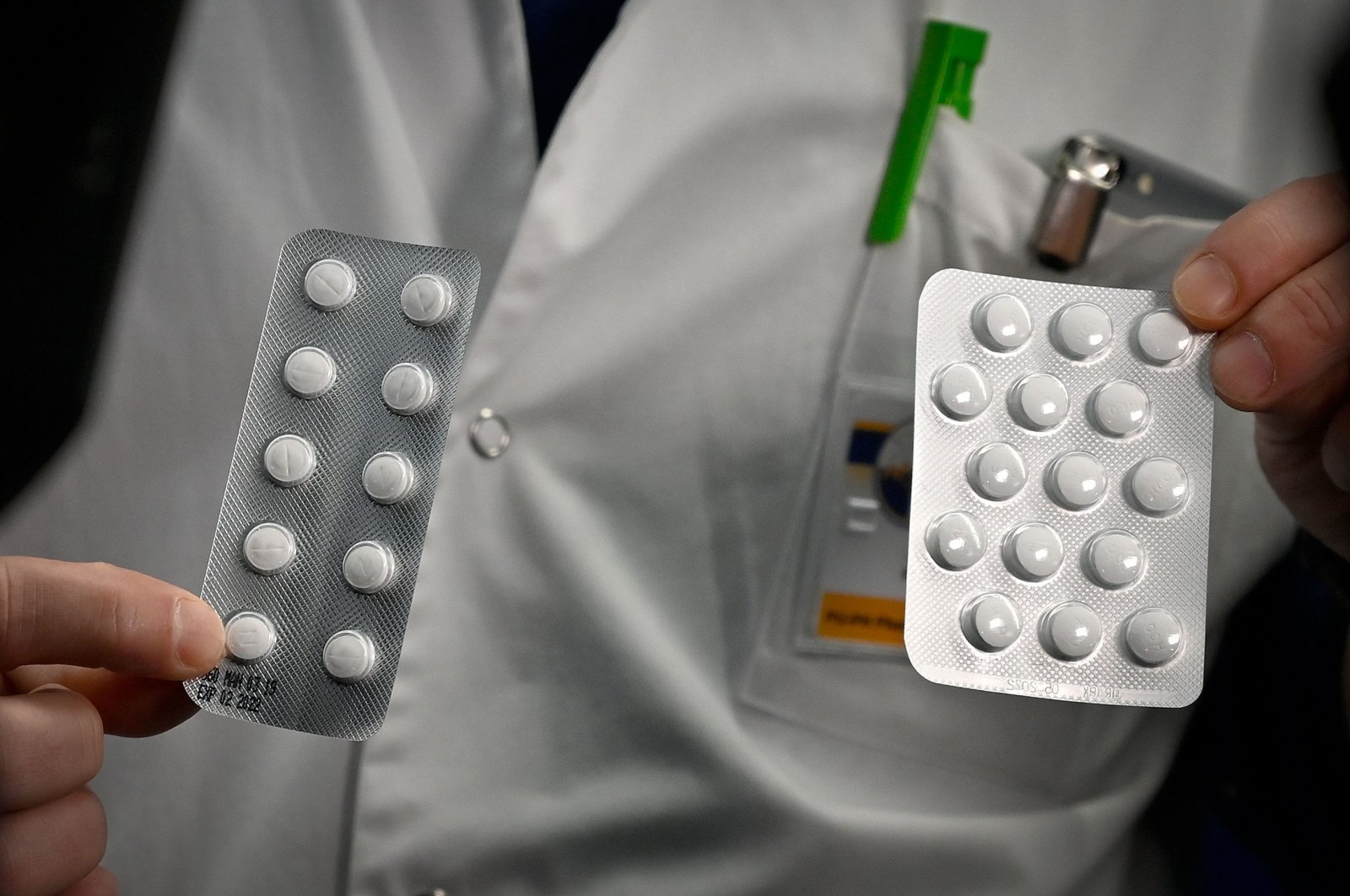 Medical personnel at the IHU Méditerranée Infection Institute in Marseille, packets of a Nivaquine, tablets containing chloroquine and Plaqueril, tablets containing hydroxychloroquine, drugs that have shown signs of effectiveness against coronavirus, Feb. 26, 2020. (AFP Photo)