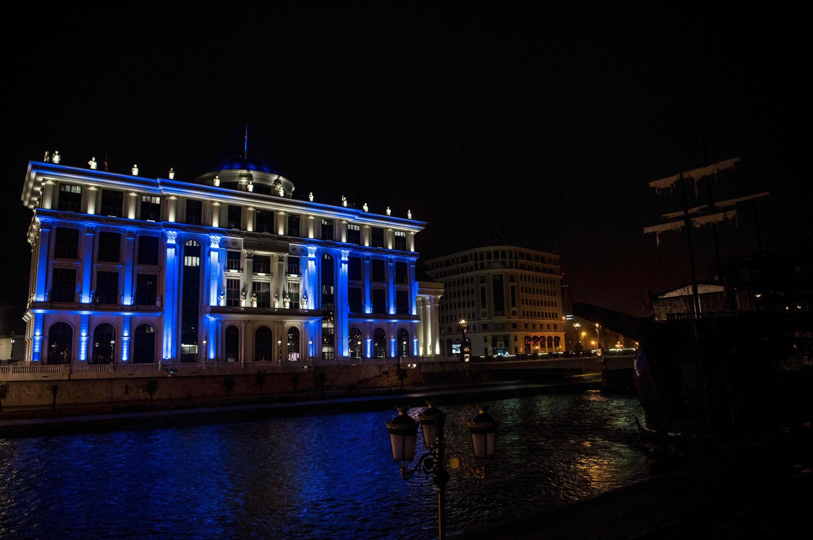 A picture shows the building of the North Macedonian Ministry of Foreign Affairs, illuminated in the colors of the North Atlantic Treaty Organization (NATO), in Skopje, , Saturday, March 27, 2020, (AFP)