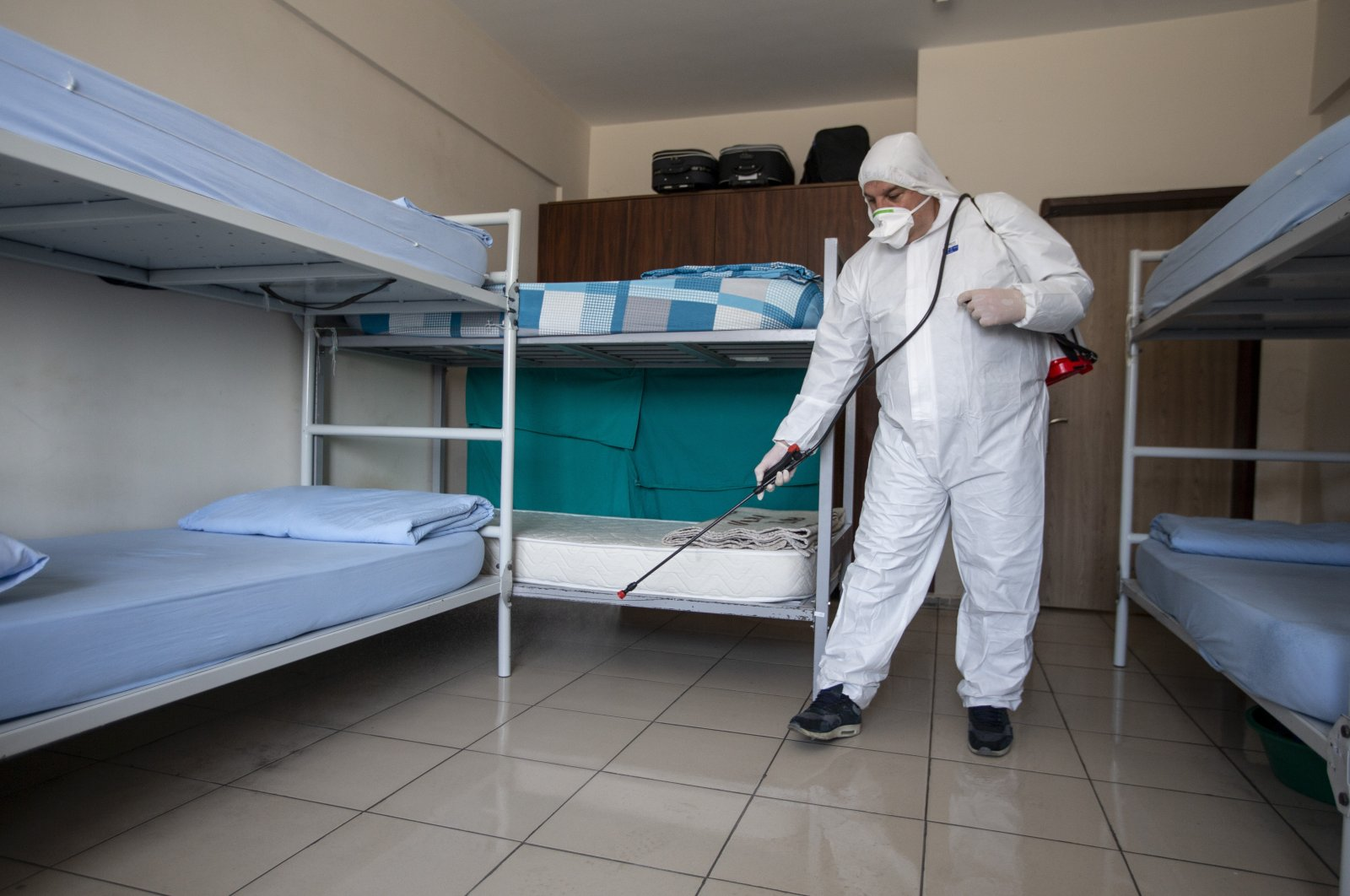 A staff member disinfects a prison in Ankara's Sincan district earlier this month. Justice minister Gül earlier announced that there were no coronavirus cases in prisons in the country, where about 300,000 people remain incarcerated. (AA Photo)