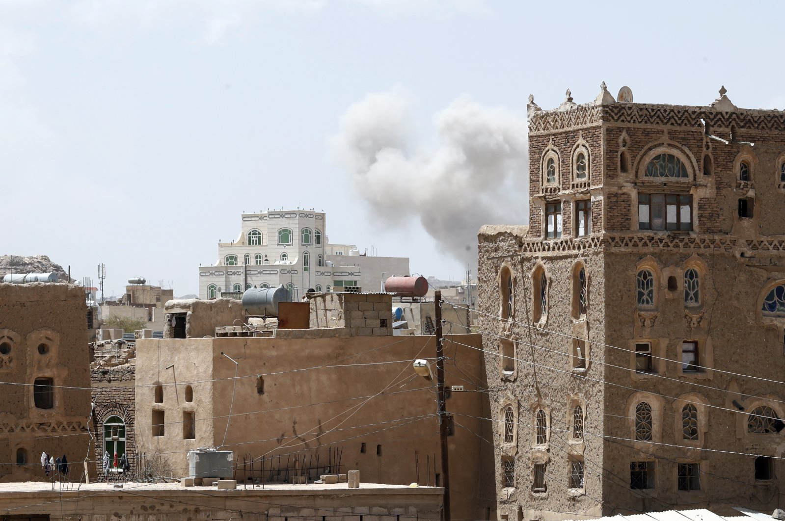 Smoke billows above a neighborhood following Saudi-led airstrikes targeting a Houthi-held position, a day after the Houthis fired ballistic missiles at the Saudi capital Riyadh, Sanaa, Yemen, March 30, 2020. (EPA Photo)