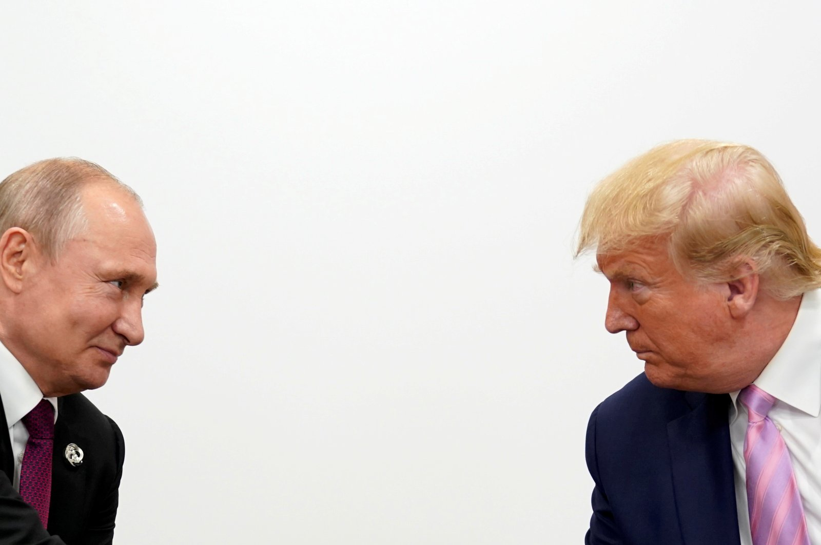 Russian President Vladimir Putin (L) and U.S. President Donald Trump hold a bilateral meeting at the G-20 leaders' summit in Osaka, Japan, June 28, 2019. (Reuters Photo)