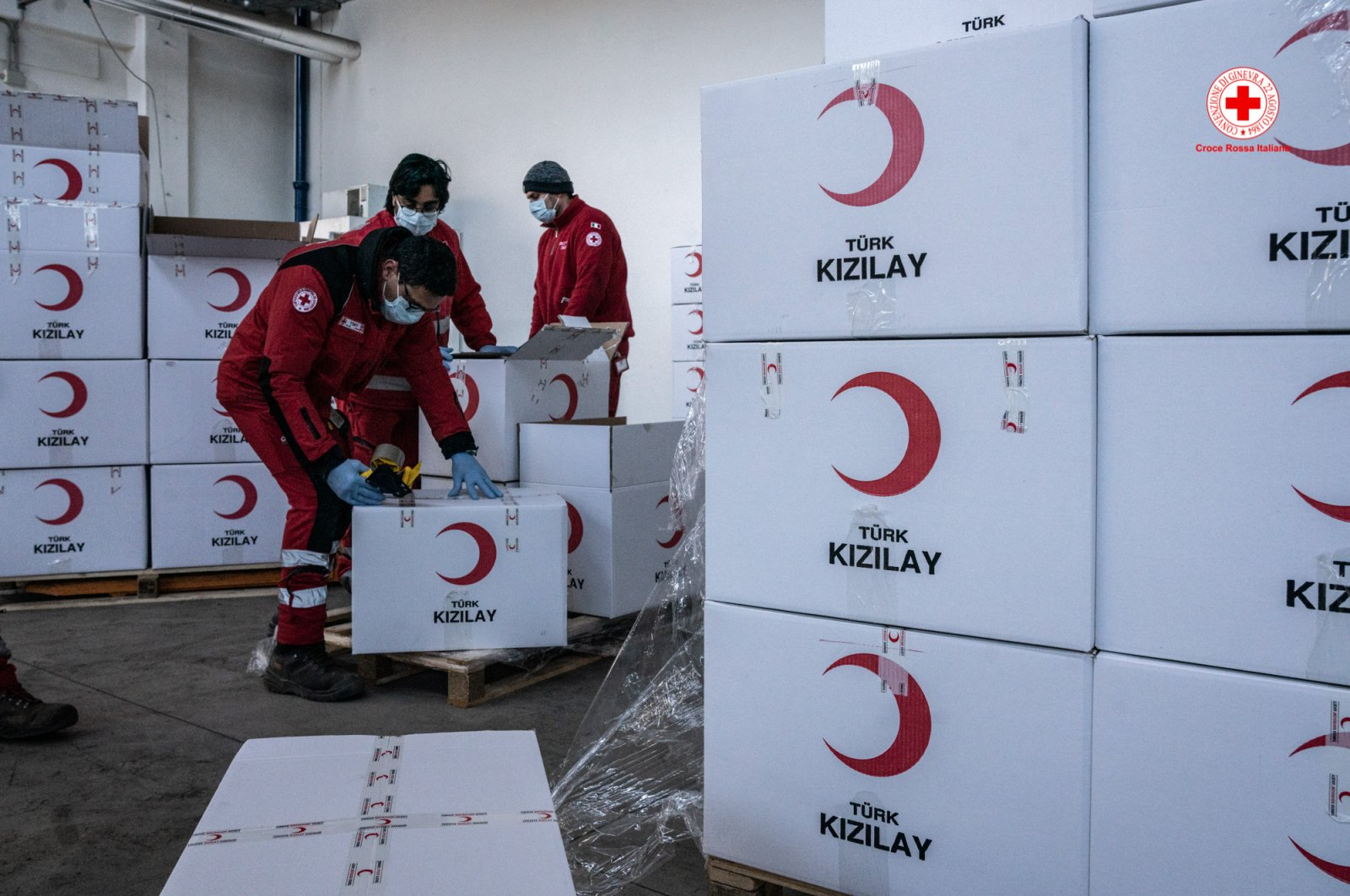 Italian Red Cross workers unpack medical supplies sent by the Turkish Red Crescent in this undated photo. (Photo courtesy of Croce Rossa Italiana)