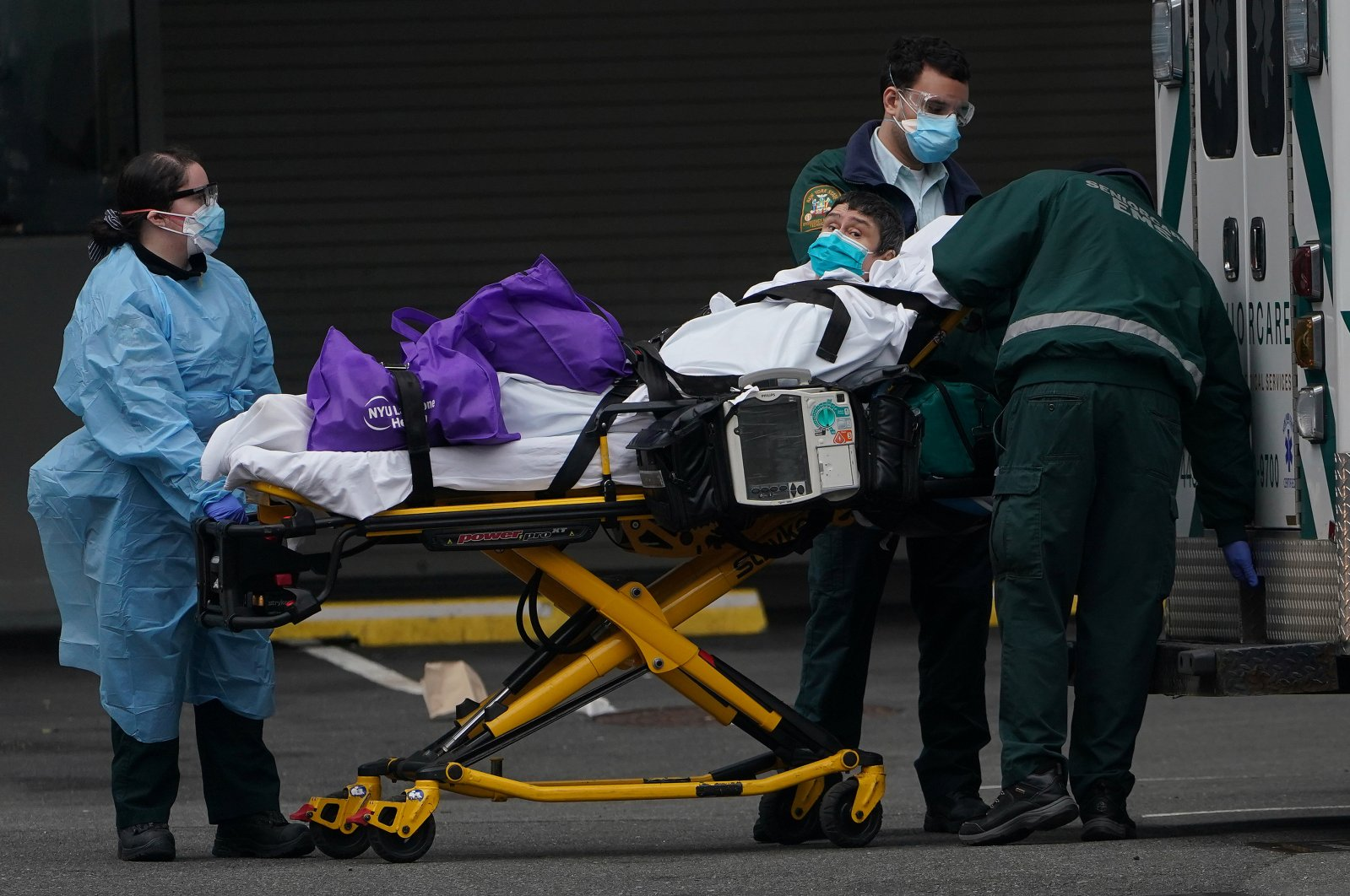 Paramedics move a patient into the hospital during the outbreak of the coronavirus, in the Manhattan borough of New York City, New York, U.S., Wednesday, March 25, 2020. (Reuters Photo)