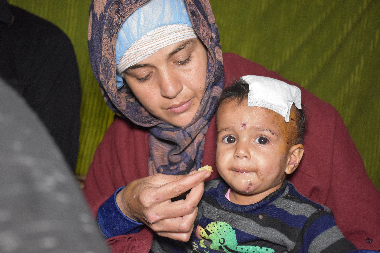 Hitam Qutaish and her son Mira (AA Photo)