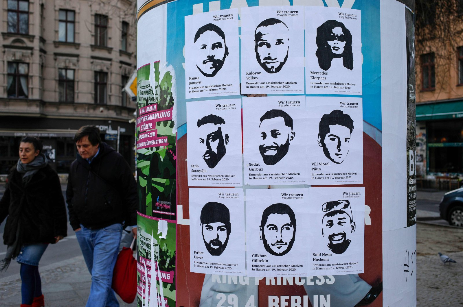 Posters with the pictures and names of the victims of a right-wing extremist gunman, who killed nine people in a racist terror attack in Hanau on Feb. 19, 2020, were posted up on an advertising column in Berlin's Kreuzberg district on Thursday, March 19, 2020. (AFP Photo)